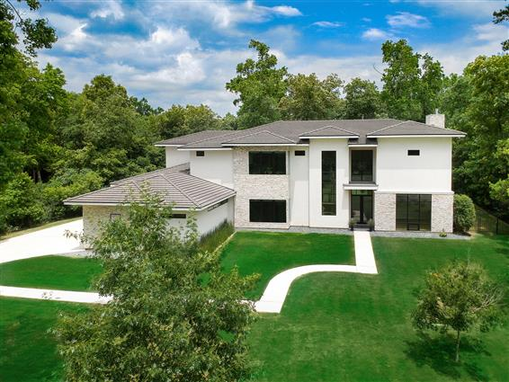 elevated photography of Friendswood, TX home with drone
